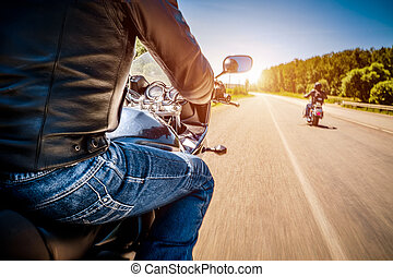 Bikers First-person view - Bikers driving a motorcycle rides...