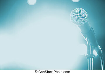 Microphone on stage with shiny rays as the background