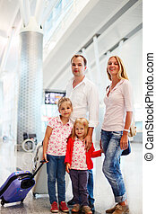 Portrait of traveling family in airport