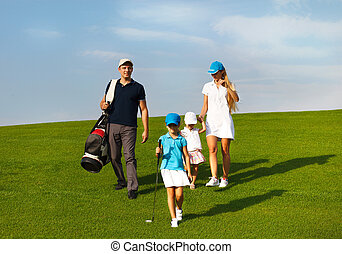 Family of golf players at the course - Family of golf...