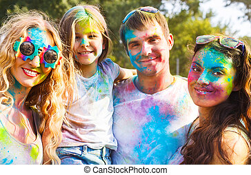 Happy friends on holi color festival - Portrait of happy...
