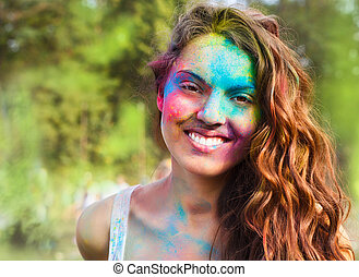Happy young girl on holi color festival - Portrait of happy...