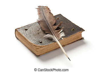 Old book and a fountain pen on white background