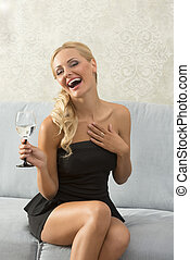 Laughing woman - Elegant, attractive, blonde woman in black...