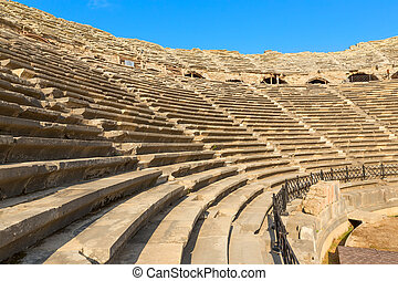 Amphitheatre with lots empty seats, ancient ruins in Side...