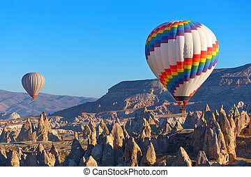 Cappadocia. - Balloons flying over rock landscape at...