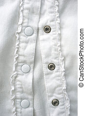 Closeup of a white shirt with buttons