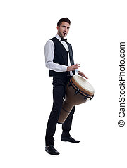 Elegant bearded man plays on percussion