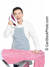 chinese young man ironing his clothes - young man ironing...