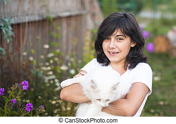 Cute teengirl with a cat outdoors