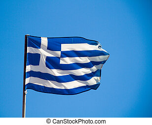 Greek flag in a blue sky.