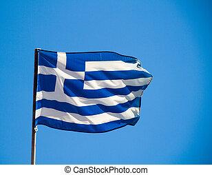 Greek flag in a blue sky.