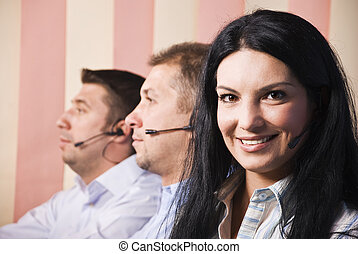 Friendly customer service woman with team - Beautiful...
