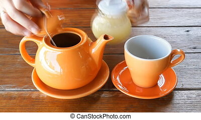 Hot Lemon Tea Pouring From Ceramic Pot