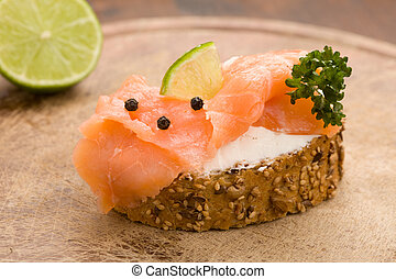 Slice of Bread with creme fraiche and smoked salmon - photo...
