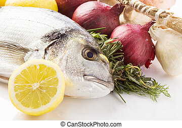 Bream - photo of bream with different ingredients on white...