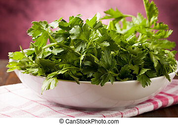 Parsley - photo of fresh green parsley inside a bowl on...