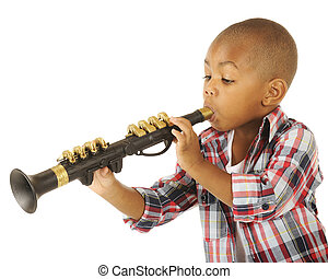 Blowing His Horn - A handsome preschooler blowing his toy...