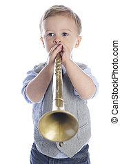 Blowing His Horn - An adorable preschooler blowing a golden...