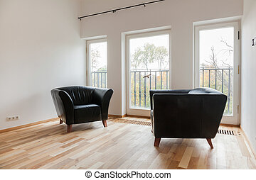 Leather black armchairs - Cozy room with comfortable leather...