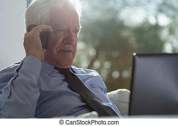 Businessman with grey hair - Elegant businessman with grey...