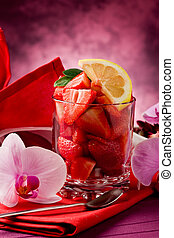 Strawberries with Orchid on red table - photo of delicius...
