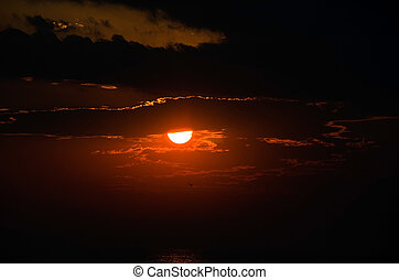 sunset over Lake Michigan - Glowing sunset with clouds over...