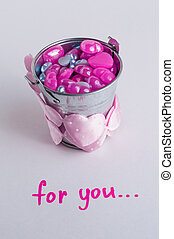 Metallic silver bucket filled with little hearts Tape...