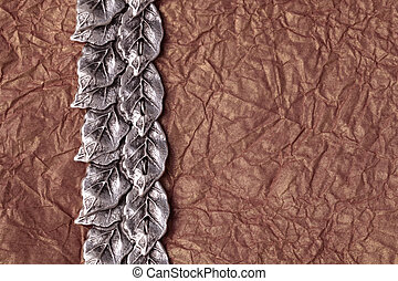 crumpled tissue paper texture for background - silver leaves...
