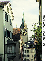 Clock tower of St Peters Church and street view, Zurich,...