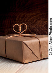 Gift Packed in paper and tied with a thread in the shape of...