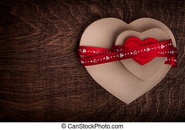 Valentines dayTwo cardboard hearts, wrapped with a red...