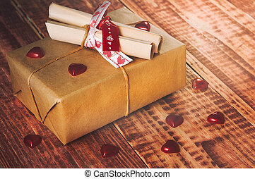 Valentines dayCardboard box tied with a thread, with paper...
