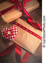 Gift tied with a ribbon and red heart from the tissues in...