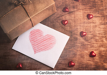 Valentines day White card with a heart on wooden background...