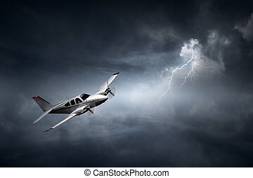 Aeroplane in thunderstorm - Aeroplane flying in storm with...
