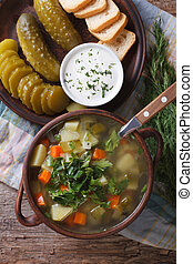 Polish soup with sour cucumbers on the table. vertical top...