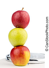 apples on a balance - several apples on a balance of people...