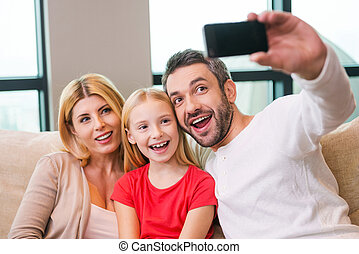 Capturing a bright moment together Happy family of three...