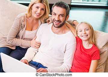 Family shopping online. Top view of happy family of three...