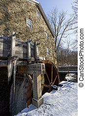 Gristmill water wheel frozen in ice New Jersey