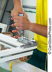 Hand drill - Worker in workshop