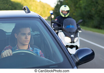 Traffic Controle - Policeman and young driwer in traffic