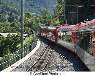 railway in the swiss alps - mountain express throught the...