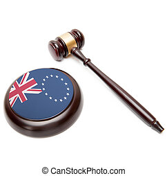 Judge gavel and soundboard with national flag on it - Cook...