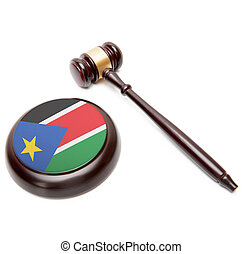 Judge gavel and soundboard with national flag on it - South...