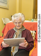Grandma learning to use a tablet for business