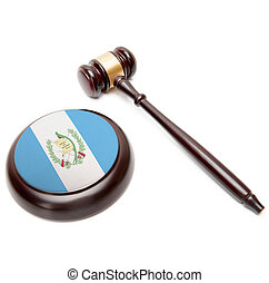 Judge gavel and soundboard with national flag on it -...