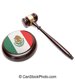 Judge gavel and soundboard with national flag on it - Mexico