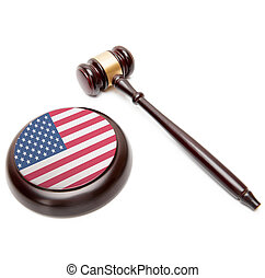 Judge gavel and soundboard with national flag on it - United...